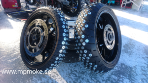 Motorbike tyres with spikes.